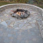 thoma res. calico flag, local fieldstone firering, estate wall river, maduro bluestone and mesa pavers, indiana limestone caps